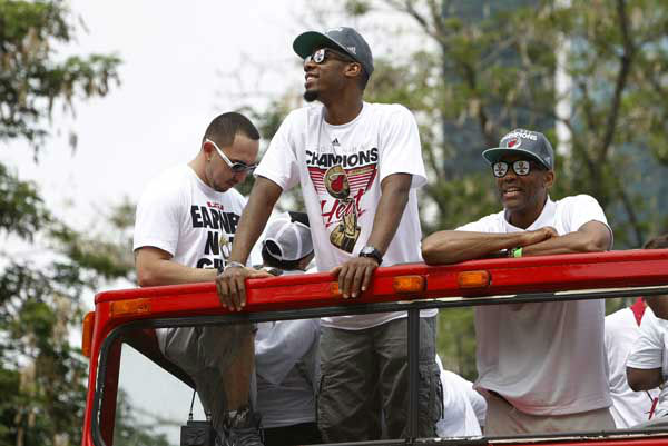 Miami Heat&#39;s Norris Cole, center, looks out from a double decker bus during a parade in celebration of winning the NBA Finals basketball championship against the Oklahoma City Thunder, Monday, June 25, 2012, in Miami. &#40;AP Photo&#47;Lynne Sladky&#41; <span class=meta>(AP Photo&#47; Lynne Sladky)</span>