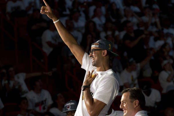 "<div class=""meta ""><span class=""caption-text "">Miami Heat's Juwan Howard gestures to the crowd at a public celebration of their NBA Championship in Miami, Monday, June 25, 2012. (AP Photo/J Pat Carter) (AP Photo/ J Pat Carter)</span></div>"