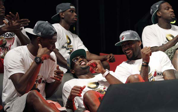 "<div class=""meta ""><span class=""caption-text "">Miami Heat's Dwyane Wade, center, Chris Bosh, left, and LeBron James share a light moment during a public celebration of their NBA Championship in Miami, Monday, June 25, 2012. (AP Photo/ Alan Diaz)</span></div>"