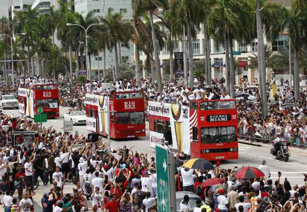 Miami Heat players ride in double-decker buses during a parade in Miami, Monday, June 25, 2012 in celebration of winning the NBA Finals basketball championship against the Oklahoma City Thunder. &#40;AP Photo&#47;Wilfredo Lee&#41; <span class=meta>(AP Photo&#47; Wilfredo Lee)</span>