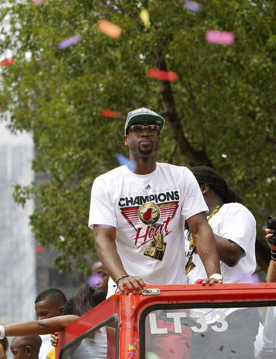 Miami Heat&#39;s Dwyane Wade looks out from a double decker bus during a parade in celebration of winning the NBA Finals basketball championship against the Oklahoma City Thunder, Monday, June 25, 2012, in Miami. &#40;AP Photo&#47;Lynne Sladky&#41; <span class=meta>(Photo&#47;Lynne Sladky)</span>