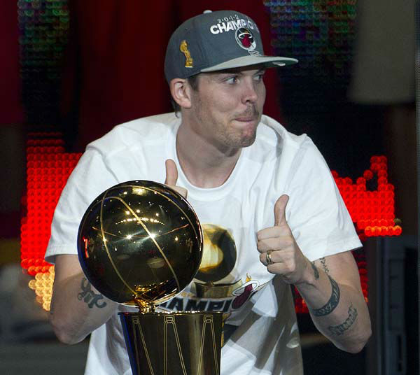 Miami Heat&#39;s Mike Miller celebrates with the NBA Championship trophy during a public celebration for the team Monday, June 25, 2012 in Miami. &#40;AP Photo&#47;J Pat Carter&#41; <span class=meta>(AP Photo&#47; J Pat Carter)</span>