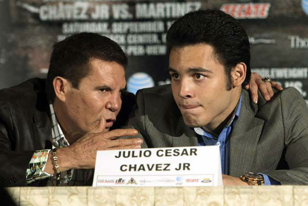 Julio Cesar Chavez Jr., right, of Mexico, talks with his father, legendary boxer Julio Cesar Chavez, left, at a news conference to promote his upcoming middleweight championship boxing match with Sergio Martinez, of Argentina, in Los Angeles, Tuesday, July 10, 2012. The pair are scheduled to fight on Sept. 15 in Las Vegas. &#40;AP Photo&#47;Reed Saxon&#41; <span class=meta>(AP Photo&#47; Reed Saxon)</span>