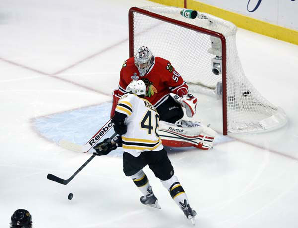 Boston Bruins center David Krejci &#40;46&#41; shotos against Chicago Blackhawks goalie Corey Crawford &#40;50&#41; during the first period of Game 1 in their NHL Stanley Cup Final hockey series, Wednesday, June 12, 2013 in Chicago. &#40;AP Photo&#47;Charles Rex Arbogast&#41; <span class=meta>(AP Photo&#47; Charles Rex Arbogast)</span>