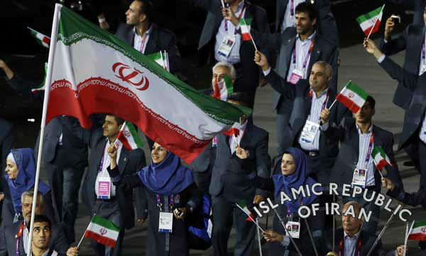 "<div class=""meta ""><span class=""caption-text "">Iran's Ali Mazaheri carries the flag during the Opening Ceremony at the 2012 Summer Olympics, Friday, July 27, 2012, in London. (AP Photo/Paul Sancya) (AP Photo/ Paul Sancya)</span></div>"