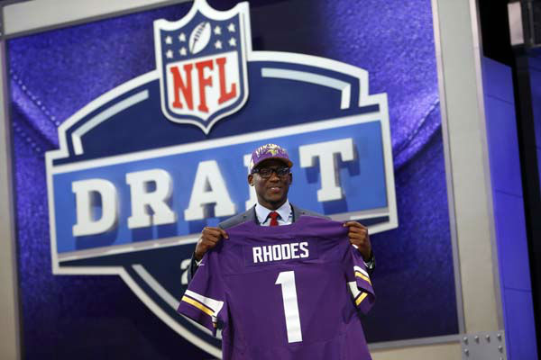 "<div class=""meta ""><span class=""caption-text "">Xavier Rhodes, from Florida State, holds up a team jersey after being selected 25th overall by the Minnesota Vikings in the first round of the NFL football draft, Thursday, April 25, 2013, at Radio City Music Hall in New York. (AP Photo/Jason DeCrow) (AP Photo/ Jason DeCrow)</span></div>"