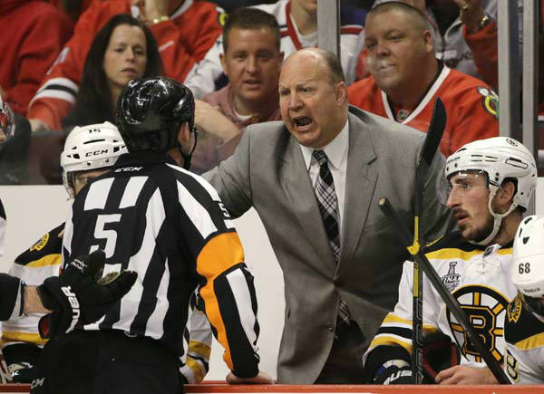 Boston Bruins head coach Claude Julien argues with an official &#40;5&#41; during the second period of Game 1 in their NHL Stanley Cup Final hockey series against the Chicago Blackhawks, Wednesday, June 12, 2013, in Chicago. &#40;AP Photo&#47;Nam Y. Huh&#41; <span class=meta>(AP Photo&#47; Nam Y. Huh)</span>