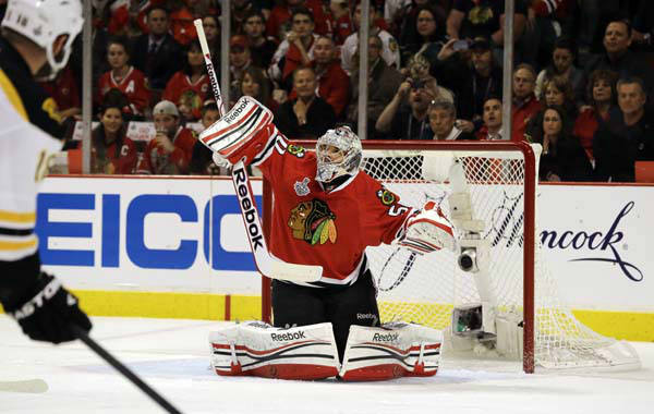 Chicago Blackhawks goalie Corey Crawford &#40;50&#41; blocks a shot during the first period of Game 1 in their NHL Stanley Cup Final hockey series against the Boston Bruins, Wednesday, June 12, 2013, in Chicago. &#40;AP Photo&#47;Nam Y. Huh&#41; <span class=meta>(AP Photo&#47; Nam Y. Huh)</span>