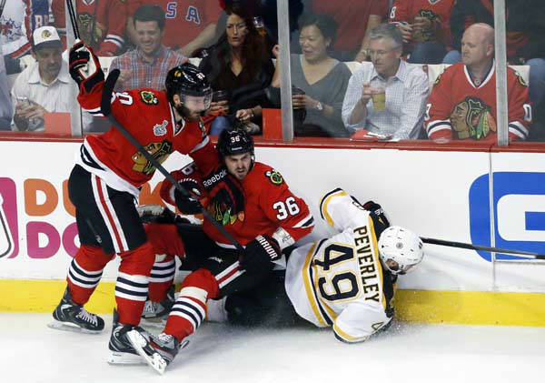 Chicago Blackhawks left wing Brandon Saad &#40;20&#41; and center Dave Bolland &#40;36&#41; collide with Boston Bruins center Rich Peverley &#40;49&#41; during the first period of Game 1 in their NHL Stanley Cup Final hockey series,Wednesday, June 12, 2013 in Chicago. &#40;AP Photo&#47;Charles Rex Arbogast&#41; <span class=meta>(AP Photo&#47; Charles Rex Arbogast)</span>