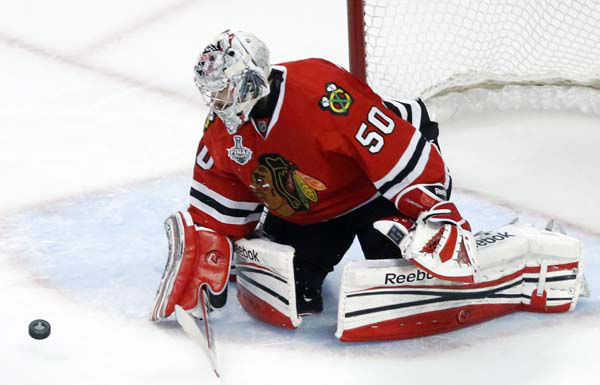 Chicago Blackhawks goalie Corey Crawford &#40;50&#41; blocks a shot during the third period of Game 1 in their NHL Stanley Cup Final hockey series against the Boston Bruins,Wednesday, June 12, 2013 in Chicago. &#40;AP Photo&#47;Charles Rex Arbogast&#41; <span class=meta>(AP Photo&#47; Charles Rex Arbogast)</span>