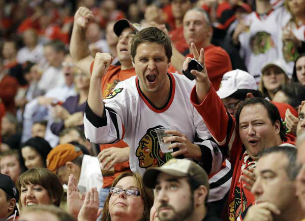 "<div class=""meta ""><span class=""caption-text "">Fans cheer during the third period of Game 1 in their NHL Stanley Cup Final hockey series between the Chicago Blackhawks and the Boston Bruins, Wednesday, June 12, 2013, in Chicago. (AP Photo/Nam Y. Huh) (AP Photo/ Nam Y. Huh)</span></div>"