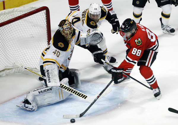 Boston Bruins goalie Tuukka Rask &#40;40&#41; and defenseman Dennis Seidenberg &#40;44&#41; defend against Chicago Blackhawks right wing Patrick Kane &#40;88&#41; during the second overtime period of Game 1 in their NHL Stanley Cup Final hockey series,Wednesday, June 12, 2013 in Chicago. &#40;AP Photo&#47;Charles Rex Arbogast&#41; <span class=meta>(AP Photo&#47; Charles Rex Arbogast)</span>
