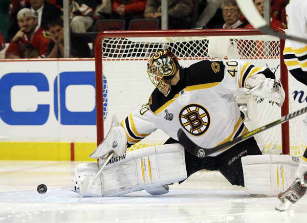 Boston Bruins goalie Tuukka Rask &#40;40&#41; blocks a shot by Chicago Blackhawks center Andrew Shaw &#40;65&#41; during the first overtime period of Game 1 in their NHL Stanley Cup Final hockey series, Wednesday, June 12, 2013, in Chicago. &#40;AP Photo&#47;Nam Y. Huh&#41; <span class=meta>(AP Photo&#47; Nam Y. Huh)</span>