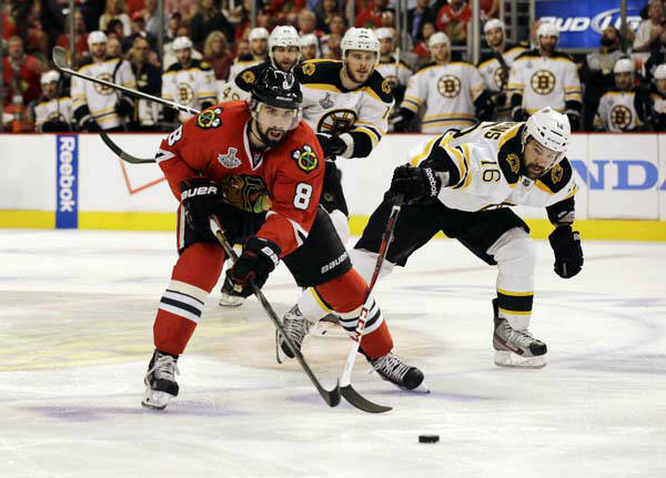 Chicago Blackhawks defenseman Nick Leddy &#40;8&#41; controls the puck against Boston Bruins left wing Kaspars Daugavins &#40;16&#41; during the first overtime period of Game 1 in their NHL Stanley Cup Final hockey series, Wednesday, June 12, 2013, in Chicago. &#40;AP Photo&#47;Nam Y. Huh&#41; <span class=meta>(AP Photo&#47; Nam Y. Huh)</span>