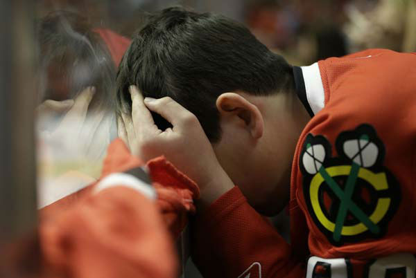 A Chicago Blackhawks fan reacts after Boston Bruins scores a goal during the third period of Game 1 in their NHL Stanley Cup Final hockey series, Wednesday, June 12, 2013, in Chicago. &#40;AP Photo&#47;Nam Y. Huh&#41; <span class=meta>(AP Photo&#47; Nam Y. Huh)</span>