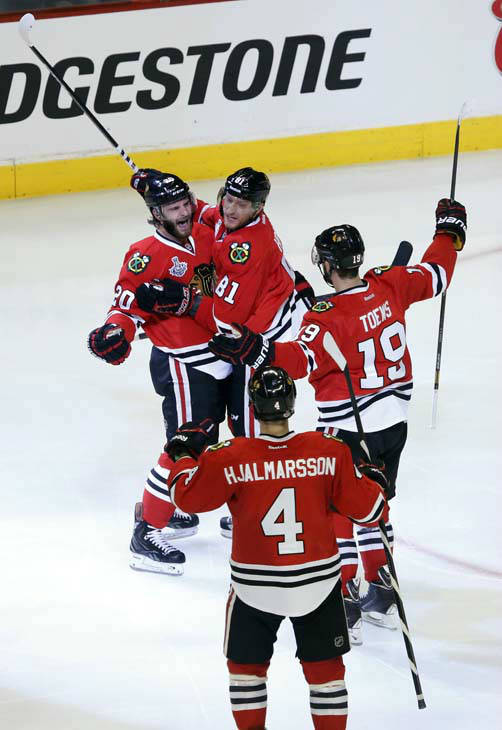Chicago Blackhawks left wing Brandon Saad &#40;20&#41; celebrates with right wing Marian Hossa &#40;81&#41;, center Jonathan Toews &#40;19&#41; and defenseman Niklas Hjalmarsson &#40;4&#41; after scoring a goal during the second period of Game 1 in their NHL Stanley Cup Final hockey series,Wednesday, June 12, 2013 in Chicago.&#40;AP Photo&#47;Charles Rex Arbogast&#41; <span class=meta>(AP Photo&#47; Charles Rex Arbogast)</span>