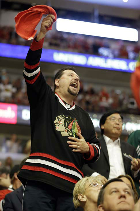 "<div class=""meta image-caption""><div class=""origin-logo origin-image ""><span></span></div><span class=""caption-text"">Fans cheer during the third period of Game 1 in their NHL Stanley Cup Final hockey series between the Chicago Blackhawks and the Boston Bruins, Wednesday, June 12, 2013, in Chicago. (AP Photo/Nam Y. Huh) (AP Photo/ Nam Y. Huh)</span></div>"