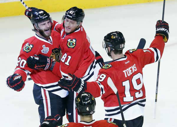 Chicago Blackhawks left wing Brandon Saad &#40;20&#41; celebrates with right wing Marian Hossa &#40;81&#41; and center Jonathan Toews &#40;19&#41; after scoring a goal during the second period of Game 1 in their NHL Stanley Cup Final hockey series against the Boston Bruins, Wednesday, June 12, 2013, in Chicago. &#40;AP Photo&#47;Charles Rex Arbogast&#41; <span class=meta>(AP Photo&#47; Charles Rex Arbogast)</span>