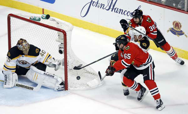 Chicago Blackhawks center Andrew Shaw &#40;65&#41;, Boston Bruins defenseman Andrew Ference and Blackhawks center Dave Bolland &#40;36&#41; battle for a control of the puck as it lands on the net while goalie Tuukka Rask &#40;40&#41; defends the goal during the second period of Game 1 in their NHL Stanley Cup Final hockey series on Wednesday, June 12, 2013, in Chicago. &#40;AP Photo&#47;Charles Rex Arbogast&#41; <span class=meta>(AP Photo&#47; Charles Rex Arbogast)</span>