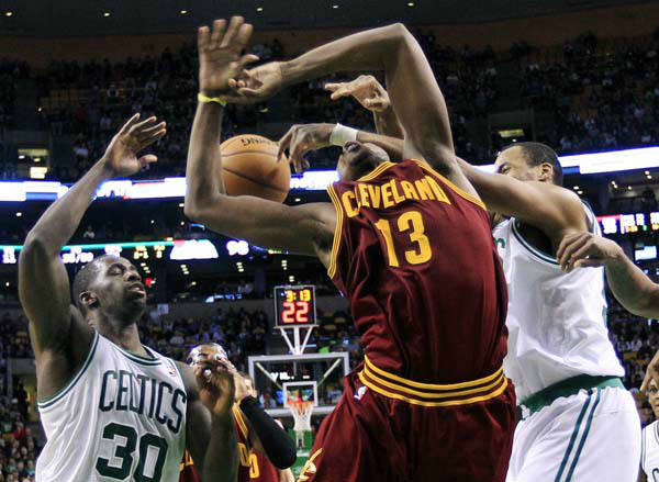 Cleveland Cavaliers forward Tristan Thompson &#40;13&#41; is fouled as he drives to the basket between Boston Celtics forward Brandon Bass &#40;30&#41; and center Jason Collins, right, during the fourth quarter of an NBA basketball game in Boston, Wednesday, Dec. 19, 2012. The Celtics won 103-91. &#40;AP Photo&#47;Elise Amendola&#41; <span class=meta>(AP Photo&#47; Elise Amendola)</span>