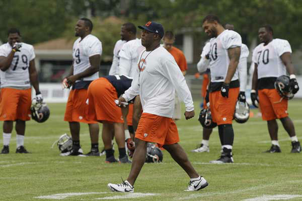 Chicago Bears head coach Lovie Smith walks as he watches his team practice on the field during NFL football training camp at Olivet Nazarene University in Bourbonnais, Ill., Thursday, July 26, 2012. &#40;AP Photo&#47;Nam Y. Huh&#41; <span class=meta>(AP Photo&#47; Nam Y. Huh)</span>