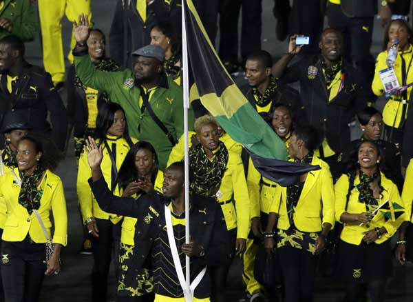 Jamaica&#39;s Usain Bolt carries the flag  during the Opening Ceremony at the 2012 Summer Olympics, Friday, July 27, 2012, in London. &#40;AP Photo&#47;Paul Sancya&#41; <span class=meta>(AP Photo&#47; Paul Sancya)</span>