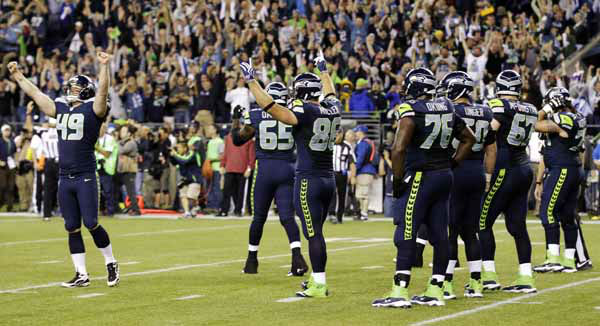 Seattle Seahawks players celebrate their 14-12 win over the Green Bay Packers after an official review allowed a late touchdown by wide receiver Golden Tate to stand in the fourth quarter of an NFL football game, Monday, Sept. 24, 2012, in Seattle. &#40;AP Photo&#47;Ted S. Warren&#41; <span class=meta>(AP Photo&#47; Ted S. Warren)</span>