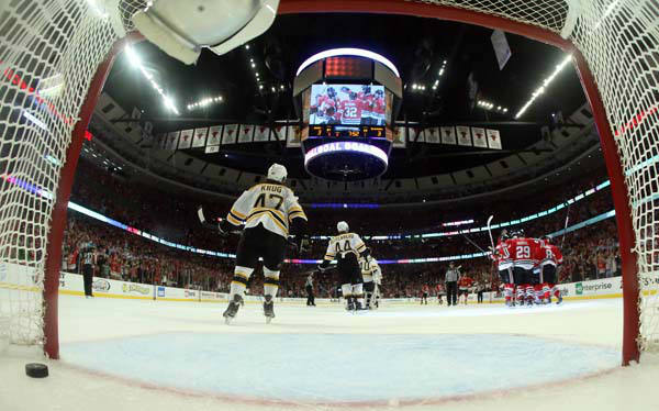 "<div class=""meta image-caption""><div class=""origin-logo origin-image ""><span></span></div><span class=""caption-text"">Chicago Blackhawks players celebrate after Andrew Shaw (65) scores the game winning goal during the third overtime period of Game 1 in their NHL Stanley Cup Final hockey series against the Boston Bruins, Wednesday, June 12, 2013, in Chicago. The Blackhawks won 4-3. (AP Photo/Bruce Bennett, Pool) (AP Photo/ Bruce Bennett)</span></div>"