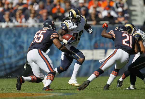 St. Louis Rams running back Steven Jackson &#40;39&#41; runs against Chicago Bears outside linebacker Lance Briggs &#40;55&#41; in the second half of an NFL football game in Chicago, Sunday, Sept. 23, 2012. &#40;AP Photo&#47;Charles Rex Arbogast&#41; <span class=meta>(AP Photo&#47; Charles Rex Arbogast)</span>