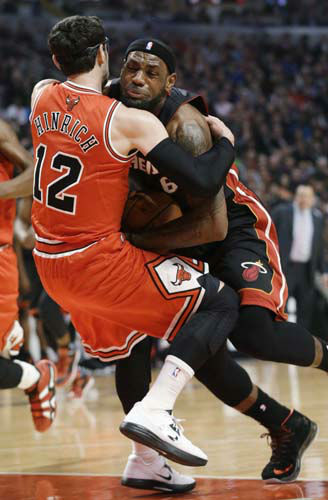 Miami Heat forward LeBron James, right, drives as Chicago Bulls guard Kirk Hinrich fouls him during the first half of an NBA basketball game in Chicago on Wednesday, March 27, 2013. &#40;AP Photo&#47;Nam Y. Huh&#41; <span class=meta>(AP Photo&#47; Nam Y. Huh)</span>
