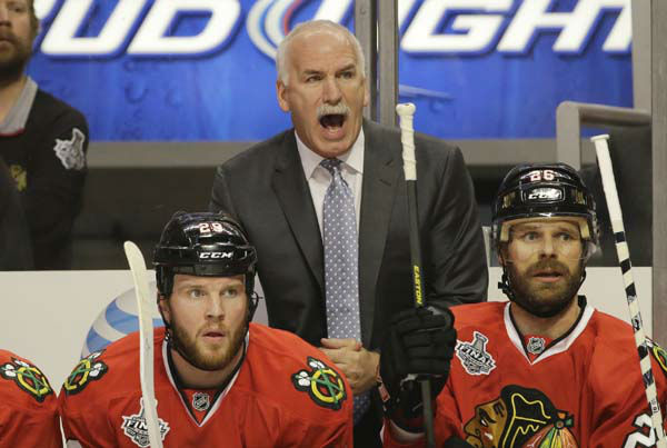 Chicago Blackhawks head coach Joel Quenneville directs his team during the first period of Game 1 in their NHL Stanley Cup Final hockey series against the Boston Bruins, Wednesday, June 12, 2013, in Chicago. &#40;AP Photo&#47;Nam Y. Huh&#41; <span class=meta>(AP Photo&#47; Nam Y. Huh)</span>