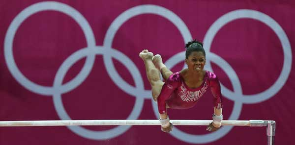 U.S. gymnast Gabrielle Douglas performs on the uneven bars during the artistic gymnastics women&#39;s individual all-around competition final at the 2012 Summer Olympics, Thursday, Aug. 2, 2012, in London.  <span class=meta>(AP Photo&#47;Matt Dunham)</span>
