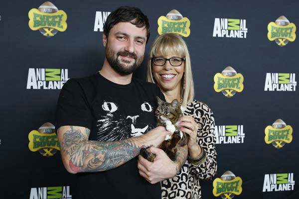 IMAGE DISTRIBUTED FOR DISCOVERY COMMUNICATIONS - Owner Mike Bridavsky, Lil BUB star of Animal Planet&#39;s Lil BUB&#39;s special special, and Animal Planet President Marjorie Kaplan attend the Puppy Bowl X at the Discovery Times Square Experience in New York on Tuesday, Jan. 28, 2014. &#40;Mark Von Holden&#47;AP Images for Discovery Communications&#41; <span class=meta>(WLS Photo&#47; Mark Von Holden)</span>