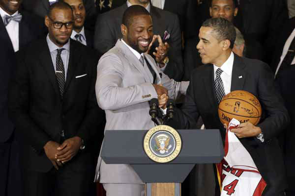 Dwyane Wade, center, shakes hands with President Barack Obama as he honors the NBA champions Miami Heat basketball team in the East Room at the White House in Washington, Monday, Jan. 28, 2013. LeBron James is seen rear left. &#40;AP Photo&#47;Charles Dharapak&#41; <span class=meta>(AP Photo&#47; Charles Dharapak)</span>