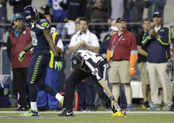 Seattle Seahawks Sidney Rice watches as side judge Lance Easley picks up a flag in the second half of an NFL football game against the Green Bay Packers, Monday, Sept. 24, 2012, in Seattle. &#40;AP Photo&#47;Ted S. Warren&#41; <span class=meta>(AP Photo&#47; Ted S. Warren)</span>