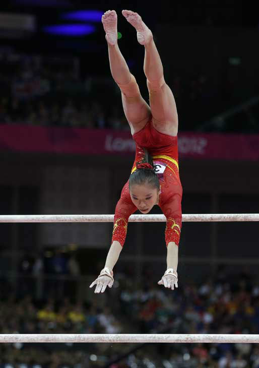 "<div class=""meta ""><span class=""caption-text "">Chinese gymnast Yao Jinnan performs on the uneven bars during the Artistic Gymnastics women's team final at the 2012 Summer Olympics, Tuesday, July 31, 2012, in London. (AP Photo/Julie Jacobson) (AP Photo/ Julie Jacobson)</span></div>"