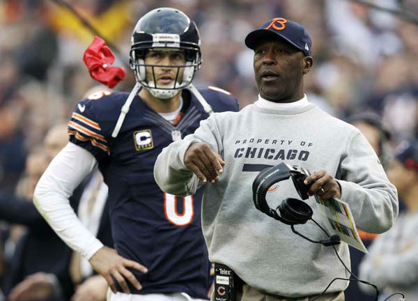 Chicago Bears head coach Lovie Smith throws a red flag to review a touchdown play in the second half against the Seattle Seahawks in an NFL football game in Chicago, Sunday, Dec. 2, 2012. The ruling went in favor of the Bears. Looking on is Bears quarterback Jay Cutler. &#40;AP Photo&#47;Nam Y. Huh&#41; <span class=meta>(AP Photo&#47; Nam Y. Huh)</span>