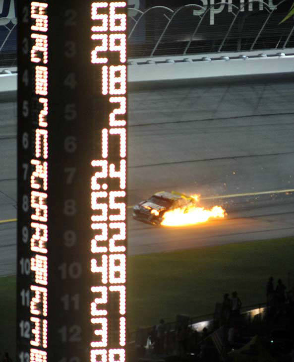 Ryan Newman&#39;s car catches fire during the NASCAR Sprint Cup Series auto race at Atlanta Motor Speedway, Sunday, Sept. 2, 2012, in Hampton, Ga. &#40;AP Photo&#47;Joe Sebo&#41; <span class=meta>(AP Photo&#47; Joe Sebo)</span>