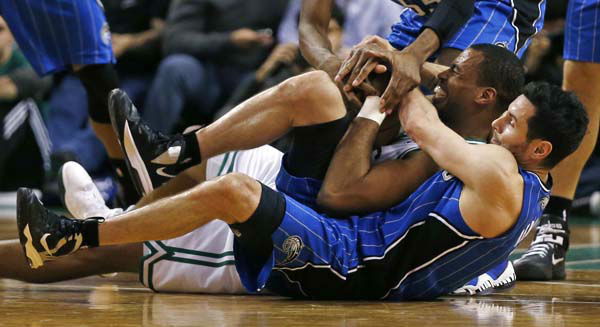 Orlando Magic guard J.J. Redick, bottom, and Boston Celtics center Jason Collins &#40;98&#41; hit the floor as they battle for the ball during the second half of an NBA basketball game in Boston, Friday, Feb. 1, 2013. The Celtics won 97-84. &#40;AP Photo&#47;Charles Krupa&#41; <span class=meta>(AP Photo&#47; Charles Krupa)</span>