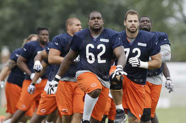 Chicago Bears guard&#40;offensive line&#41; Chilo Rachal &#40;62&#41; and tackle Gabe Carimi &#40;72&#41; stretch with teammates during NFL football training camp at Olivet Nazarene University in Bourbonnais, Ill., Thursday, July 26, 2012. &#40;AP Photo&#47;Nam Y. Huh&#41; <span class=meta>(AP Photo&#47; Nam Y. Huh)</span>