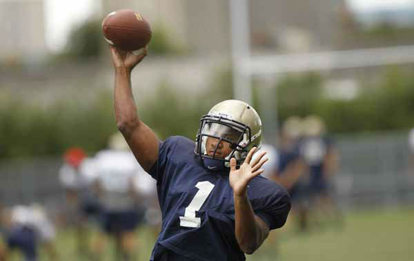 "<div class=""meta ""><span class=""caption-text "">Navy quarterback Trey Miller during a training session at the Aviva Stadium, Dublin, Ireland, Thursday, Aug. 30, 2012.  American college football team Notre Dame play the Navy team on Saturday in Dublin.  (AP Photo/Peter Morrison) (AP Photo/ Peter Morrison)</span></div>"