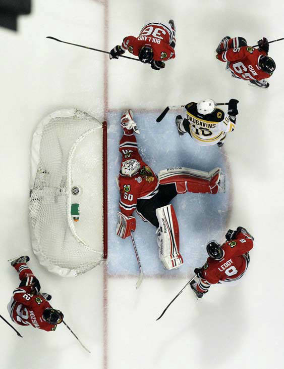 Chicago Blackhawks goalie Corey Crawford &#40;50&#41; makes a save during the first overtime period of Game 1 in their NHL Stanley Cup Final hockey series against the Boston Bruins, Thursday, June 13, 2013, in Chicago. &#40;AP Photo&#47;Nam Y. Huh&#41; <span class=meta>(AP Photo&#47; Nam Y. Huh)</span>