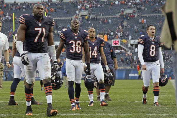 Chicago Bears players Israel Idonije &#40;71&#41;, Zack Bowman &#40;38&#41;, Eric Weems &#40;14&#41; and Adam Podlesh &#40;8&#41; walk off the field after the Bears&#39; 23-17 loss in overtime to the Seattle Seahawks in an NFL football game in Chicago, Sunday, Dec. 2, 2012. &#40;AP Photo&#47;Nam Y. Huh&#41; <span class=meta>(AP Photo&#47; Nam Y. Huh)</span>