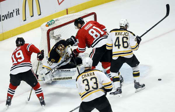 Boston Bruins goalie Tuukka Rask &#40;40&#41; makes a save on a shot by Chicago Blackhawks right wing Marian Hossa &#40;81&#41; during the first period of Game 1 in their NHL Stanley Cup Final hockey series on Wednesday, June 12, 2013, in Chicago. &#40;AP Photo&#47;Charles Rex Arbogast&#41; <span class=meta>(AP Photo&#47; Charles Rex Arbogast)</span>