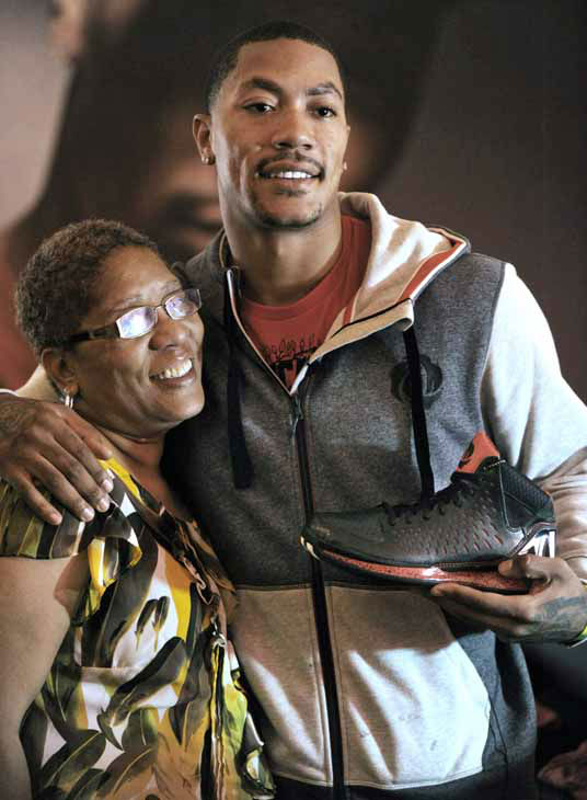 Chicago Bulls&#39; Derrick Rose poses with his mother Brenda Rose after unveiling his new shoe the Adidas D Rose 3 during a news conference in Chicago, Thursday, Sept. 13, 2012. &#40;AP Photo&#47;Paul Beaty&#41; <span class=meta>(AP Photo&#47; Paul Beaty)</span>