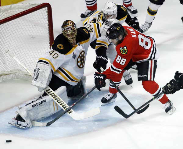 Boston Bruins goalie Tuukka Rask &#40;40&#41; makes a save on a shot by Chicago Blackhawks right wing Patrick Kane &#40;88&#41; during the second overtime period of Game 1 in their NHL Stanley Cup Final hockey series,Wednesday, June 12, 2013 in Chicago. &#40;AP Photo&#47;Charles Rex Arbogast&#41; <span class=meta>(AP Photo&#47; Charles Rex Arbogast)</span>