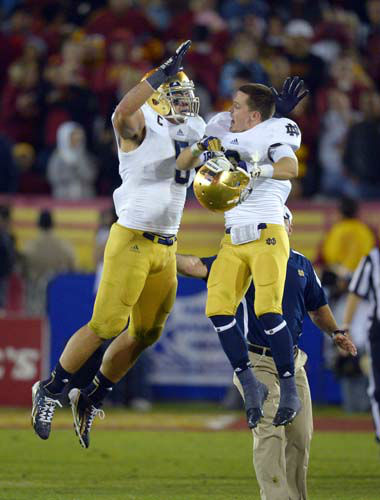 Notre Dame linebacker Manti Te&#39;o, left, celebrates with wide receiver Robby Toma in the closing seconda of an NCAA college football game against Southern California, Saturday, Nov. 24, 2012, in Los Angeles. Notre Dame won 22-13. &#40;AP Photo&#47;Mark J. Terrill&#41; <span class=meta>(AP Photo&#47; Mark J. Terrill)</span>