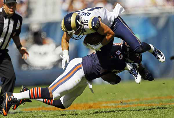 St. Louis Rams wide receiver Danny Amendola &#40;16&#41; is tripped up by Chicago Bears linebacker Lance Briggs &#40;55&#41; in the first half of an NFL football game in Chicago, Sunday, Sept. 23, 2012. &#40;AP Photo&#47;Charles Rex Arbogast&#41; <span class=meta>(AP Photo&#47; Charles Rex Arbogast)</span>