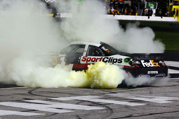 Denny Hamlin does a burnout after winning the NASCAR Sprint Cup Series auto race at Atlanta Motor Speedway, Sunday, Sept. 2, 2012, in Hampton, Ga. &#40;AP Photo&#47;Autostock, Russell LaBounty&#41; MANDATORY CREDIT <span class=meta>(AP Photo&#47; Russell LaBounty)</span>