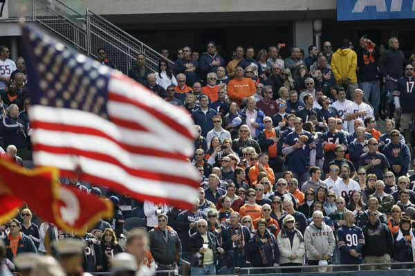 Football fans are seen during the national anthem before an NFL football game between the Chicago Bears and the St. Louis Rams in Chicago, Sunday, Sept. 23, 2012. &#40;AP Photo&#47;Nam Y. Huh&#41; <span class=meta>(AP Photo&#47; Nam Y. Huh)</span>